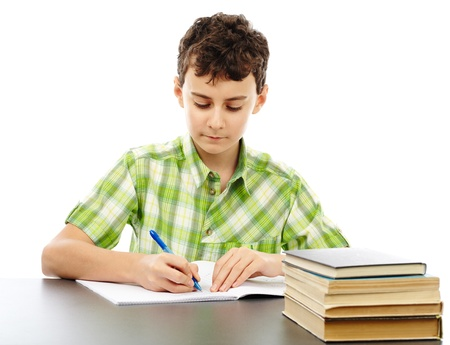 Caucasian student boy at his desk writing for homework Stock Photo - 17605326