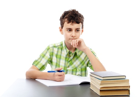 Caucasian student boy at his desk writing for homework Stock Photo - 17605333