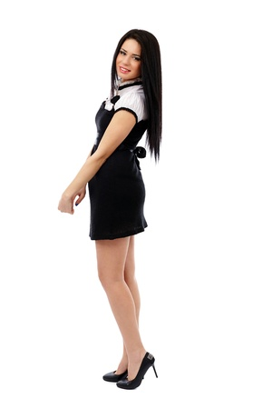 Full length portrait of a young businesswoman in black dress isolated on white background Stock Photo - 17605365