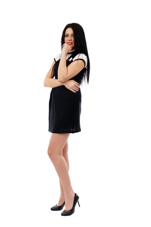 Full length portrait of a young businesswoman in black dress isolated on white background Stock Photo - 17605357