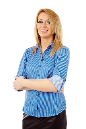 Closeup of a confident businesswoman in blue shirt with her arms folded isolated on white background photo