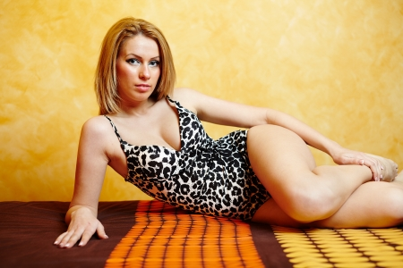 Closeup of a glamorous young blonde woman in lingerie on bed Stock Photo - 17605345