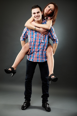 carying: Young couple piggyback Stock Photo