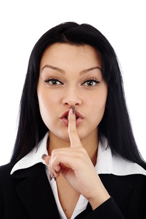 Closeup of young businesswoman making silence sign isolated on white background Stock Photo - 17893313