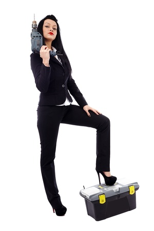Full length of a young businesswoman with construction tools over white background photo