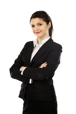 Pretty young businesswoman standing with her arms crossed in closeup pose, isolated on white background Stock Photo