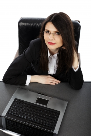 Closeup of pensive businesswoman with laptop, isolated on white background photo