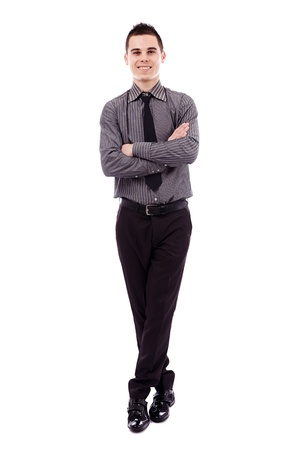 Full length pose of successful young businessman, isolated on white background, arms and legs crossed Stock Photo - 18159248