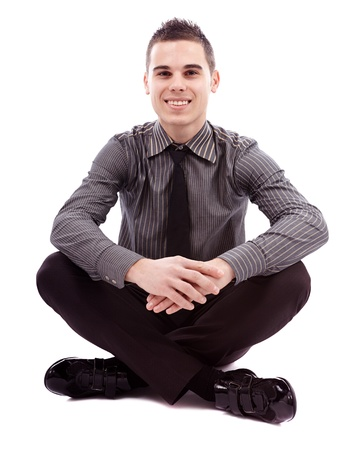 Full length pose of successful businessman sitting cross legged on the floor, isolated on white background Stock Photo - 18159182