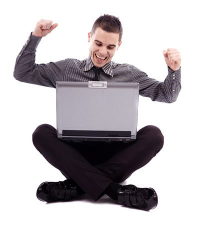 Successful young man holding his laptop on his lap, isolated on white background in full length pose Stock Photo - 18159242