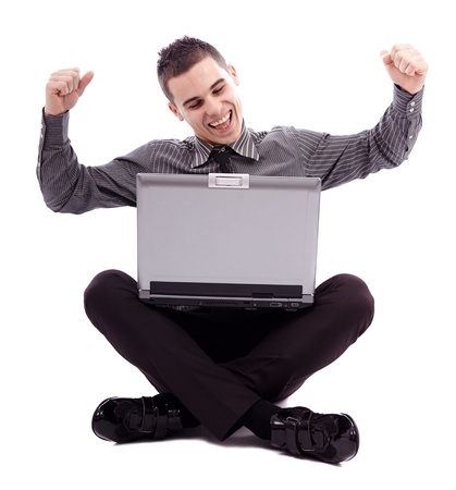 Businessman sitting on the floor with his laptop, celebrating news of success in full length pose, isolated over white background Stock Photo - 18159212