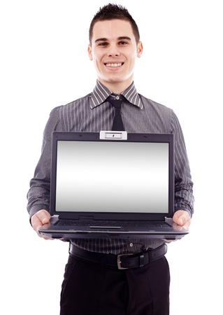 Young businessman presenting a laptop in closeup pose, isolated on white background, copyspace available photo