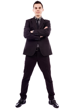 crossed arms: Confident young businessman standing with his arms crossed in full length pose, isolated on white background, business concept