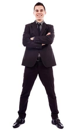 beine spreizen: Lächelnde junge Geschäftsmann stand mit verschränkten Armen in voller Länge Pose, isoliert auf weißem Hintergrund, Business-Konzept Lizenzfreie Bilder