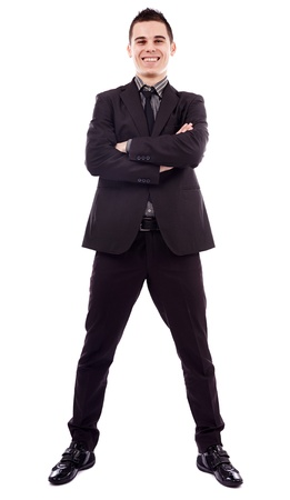 Smiling young businessman standing with his arms crossed in full length pose, isolated on white background, business concept Stock Photo - 18159241