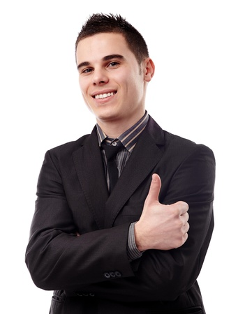 Closeup of smiling young man giving thumb up, isolated on white background photo