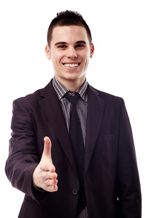 Smiling young businessman giving hand for handshake in closeup pose, isolated over white background Stock Photo - 18159179
