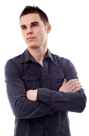 Closeup pose of a pensive young man, isolated on white background, arms crossed Stock Photo - 18159166