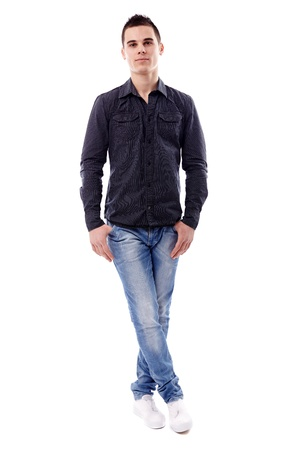 Casual young man standing with his legs crossed, in full length pose, isolated on white background Stock Photo - 18159190