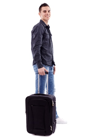 Happy young man holding his luggage in full length pose, isolated on white background Stock Photo - 18159213