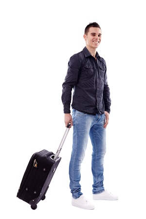 Happy young traveler carrying his luggage in full length pose, isolated on white background Stock Photo - 18159180