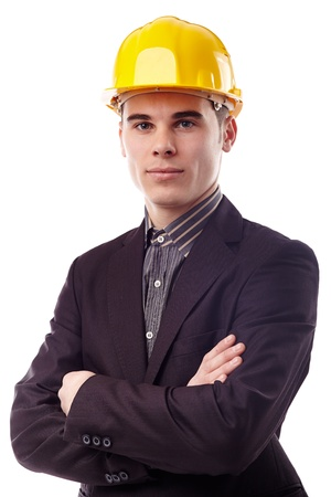 Closeup portrait of serious engineer wearing a protection helmet, arms crossed, isolated on white background photo