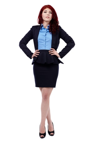 Redhead businesswoman in full length pose, isolated on white background, hands on waist Stock Photo - 18159236
