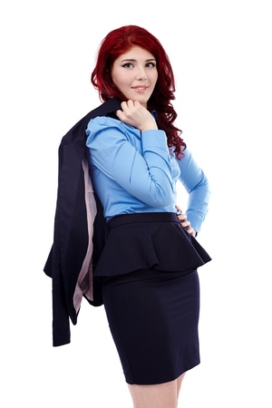 Redhead businesswoman, holding her coat over her shoulder in closeup pose, isolated on white background photo
