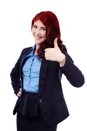Closeup of smiling young woman giving thumb up, isolated on white background photo