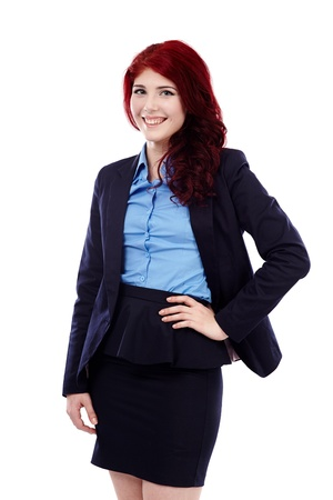 Redhead businesswoman in closeup pose, isolated on white background, hand on waist Stock Photo - 18159189