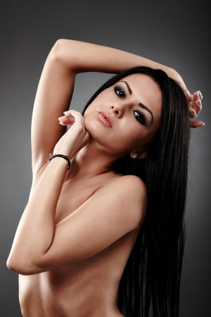 Sensual young woman in glamour closeup, on gray background Stock Photo - 18492034