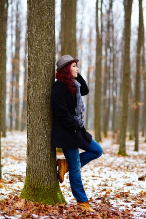 Profile view of a young girl in a forest, outdoor full length  Stock Photo - 18492014