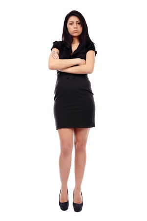 Sad Hispanic businesswoman in full length pose, arms crossed, isolated on white background photo