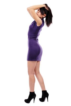 Glamour full length of Latin woman, wearing a purple mini dress, isolated on white background photo