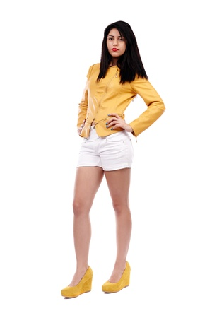 Full length shot of young Latin woman in shorts and leather jacket, isolated on white background photo