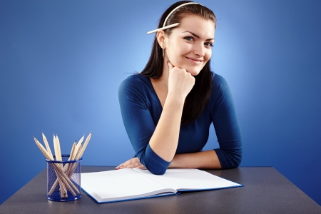 Closeup pose of a young student sitting at her desk Stock Photo - 18822061