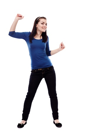woman dancing: Full length portrait of a young woman dancing isolated on white background