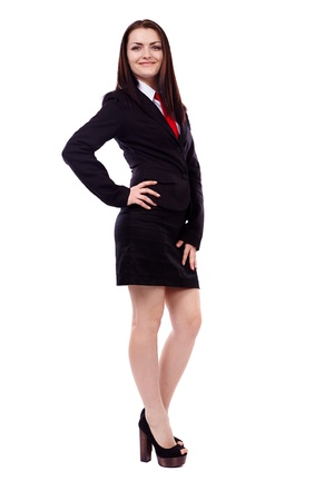 Full length portrait of a businesswoman standing with hand on hip isolated on white background Stock Photo - 19659223