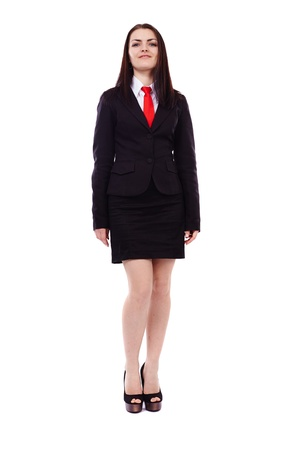 Full length portrait of a businesswoman standing isolated on white background photo
