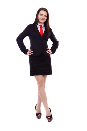 Full length portrait of a businesswoman with hands on hips isolated on white background photo