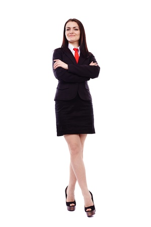 Full length portrait of a businesswoman with crossed arms isolated on white background photo