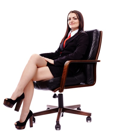 business woman legs: Full length portrait of a businesswoman sitting in an armchair isolated on white Stock Photo