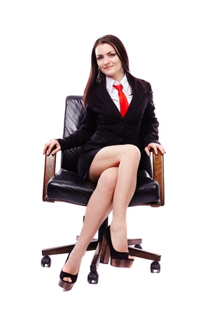 crossed legs: Full length portrait of a businesswoman sitting in an armchair isolated on white Stock Photo