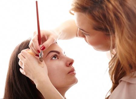 artist's model: Closeup portrait of a woman having applied makeup by makeup artist Stock Photo