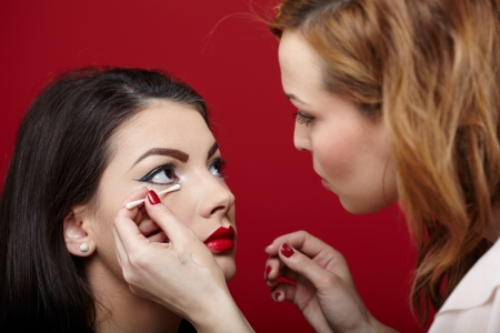 Closeup portrait of a woman having applied makeup by makeup artist Standard-Bild