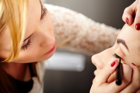 Closeup of a makeup artist applying makeup