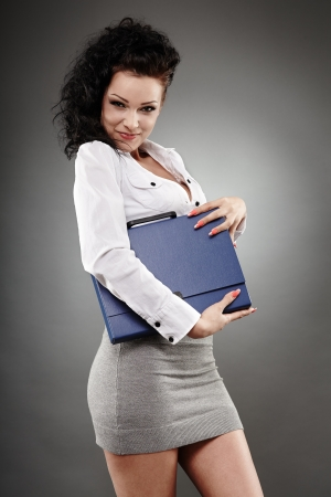 Portrait of a beautiful businesswoman holding a briefcase photo