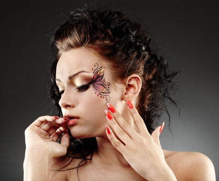 Closeup portrait of a glamour woman with facial painting photo