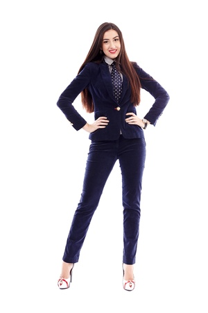 Full length portrait of a businesswoman standing with hands on hips isolated on white background photo