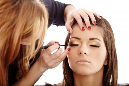 artists model: Closeup of a makeup artist applying makeup